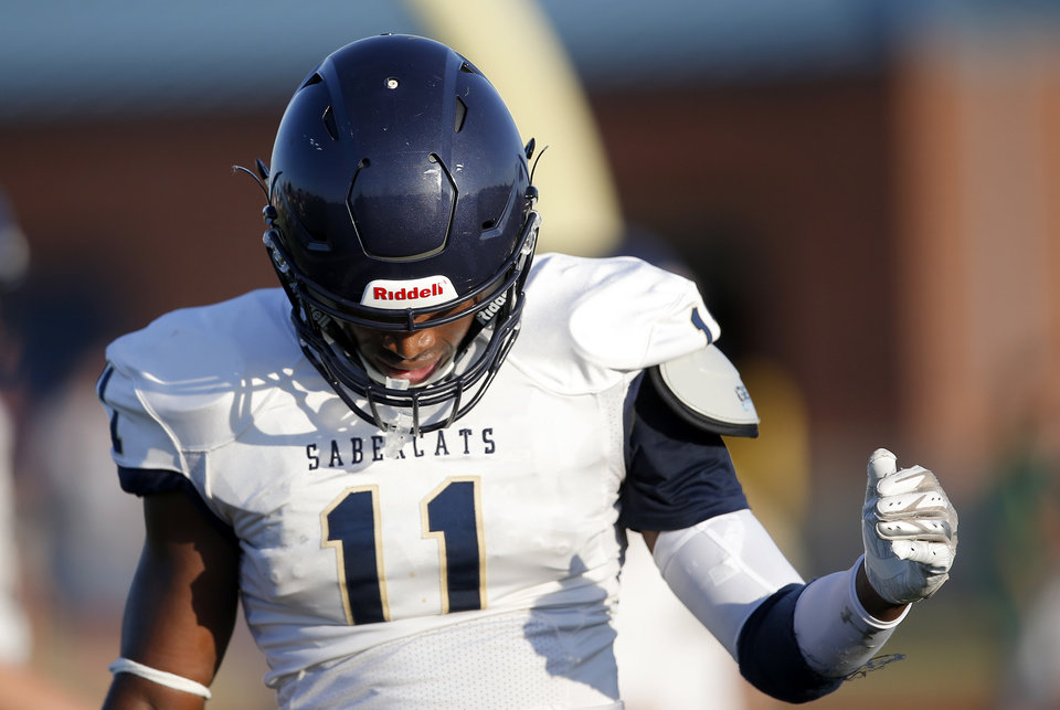 Photo - Southmoore's Jaedyn Scott reacts after a play up during a scrimmage at Southmoore High School in Moore, Okla. [Sarah Phipps/The Oklahoman]