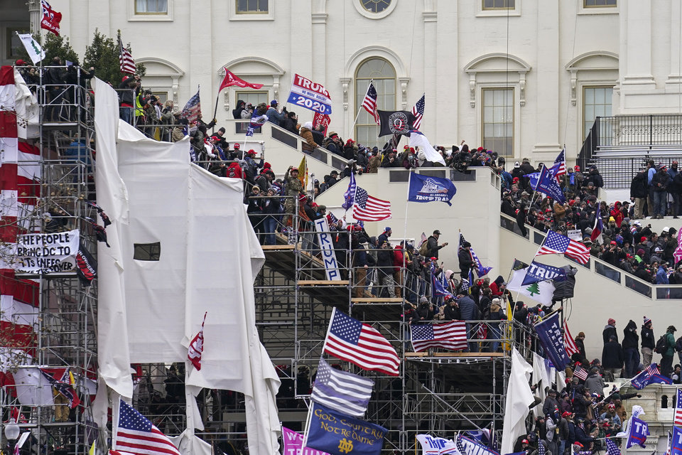 Photo - Trump supporters gather outside the Capitol, Wednesday, Jan. 6, 2021, in Washington. As Congress prepares to affirm President-elect Joe Biden's victory, thousands of people have gathered to show their support for President Donald Trump and his claims of election fraud. (AP Photo/John Minchillo)
