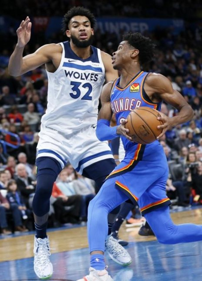 Photo -  Oklahoma City's Shai Gilgeous-Alexander (2) drives to the basket against Minnesota's Karl-Anthony Towns (32) during the second quarter of the Thunder's 139-127 overtime win Friday at Chesapeake Energy Arena. [Nate Billings/The Oklahoman]
