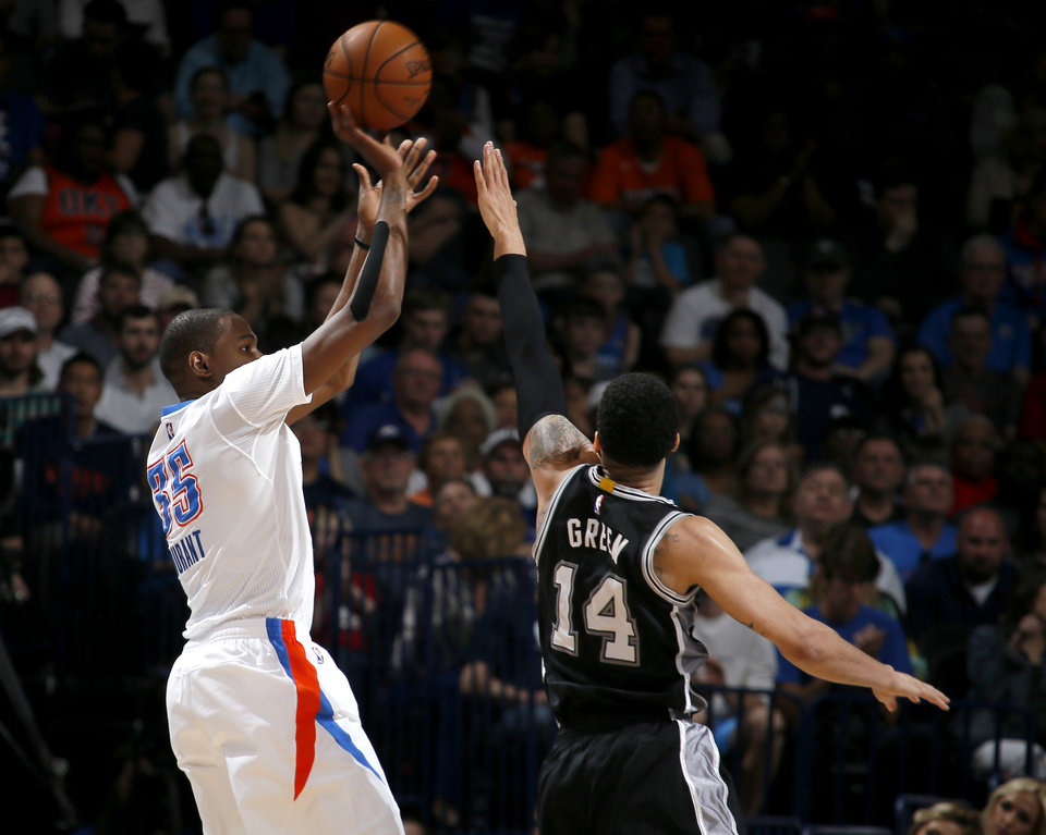 Photo - Oklahoma City's Kevin Durant (35) shoots over San Antonio's Danny Green (14) during an NBA basketball game between the Oklahoma City Thunder and the San Antonio Spurs at Chesapeake Energy Arena in Oklahoma City, Saturday, March 26, 2016. Photo by Bryan Terry, The Oklahoman