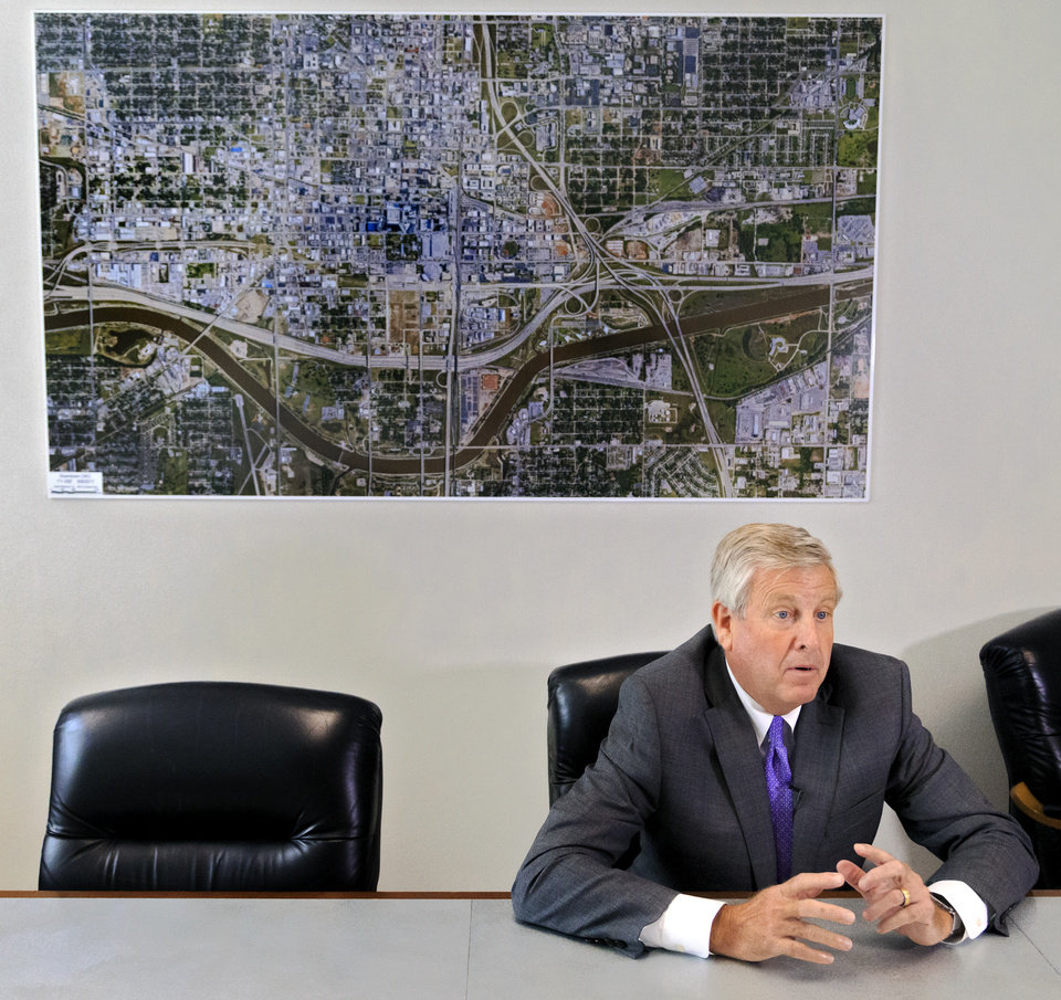 Photo -  City Manager Jim Couch speaks Monday in his office about his plan to retire Jan. 2 and discusses some of the accomplishments the city has made during his tenure. [Photo by Chris Landsberger, The Oklahoman ]