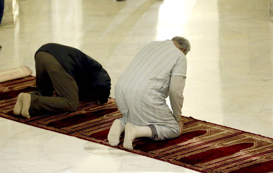Photo - Men pray during Oklahoma Muslim Day at the state Capitol in Oklahoma City Friday, Feb. 27, 2015. Photo by Sarah Phipps, The Oklahoman