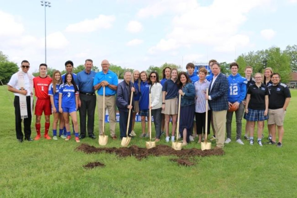 Photo -  Students, donors and administrators gather for the official groundbreaking of the new football turf at Mount St. Mary Catholic Hight School. Pictured from left to right with shovels are Chris Crosbie, Mount St. Mary athletic director; Eugene Stockinger, brother of lead project donor Gilbert Stockinger; Talita DeNegri, Mount St. Mary principal; and Kacee Glass and Woody Glass, lead project donors. [PHOTO PROVIDED]
