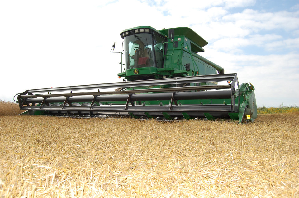 Photo -  A combine harvests wheat near Frederick in 2016. [Photo provided by the Oklahoma Wheat Commission]