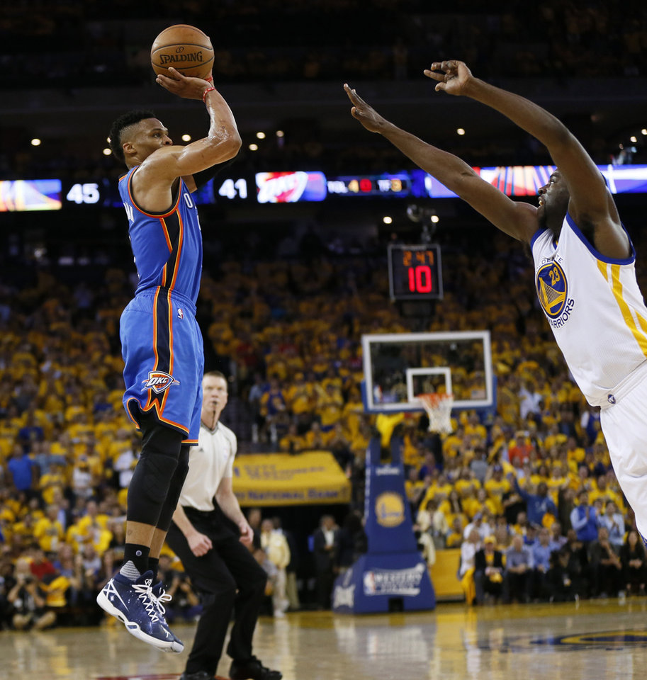 Photo - Oklahoma City's Russell Westbrook (0) shoots over Golden State's Draymond Green (23) during Game 2 of the Western Conference finals in the NBA playoffs between the Oklahoma City Thunder and the Golden State Warriors at Oracle Arena in Oakland, Calif., Wednesday, May 18, 2016. Photo by Nate Billings, The Oklahoman