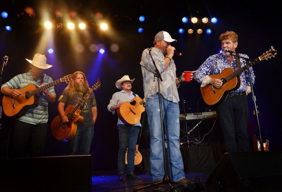 Photo - From left, Scotty Emerick, Jamey Johnson, Paul Overstreet, Toby Keith and Mac McAnally perform in concert together June at the 15th Annual Toby Keith & Friends Golf Classic in Norman. [Photo provided]