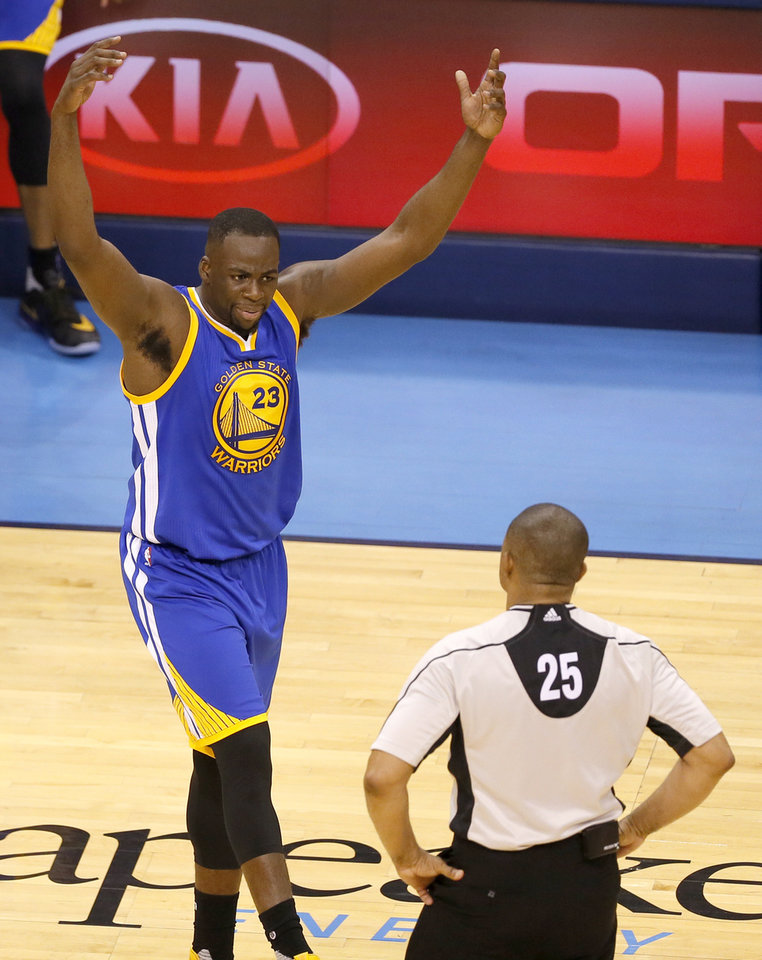 Photo - Golden State 's Draymond Green (23) argues a call  with a official during Game 3 of the Western Conference finals in the NBA playoffs between the Oklahoma City Thunder and the Golden State Warriors at Chesapeake Energy Arena in Oklahoma City, Sunday, May 22, 2016. Photo by Sarah Phipps, The Oklahoman