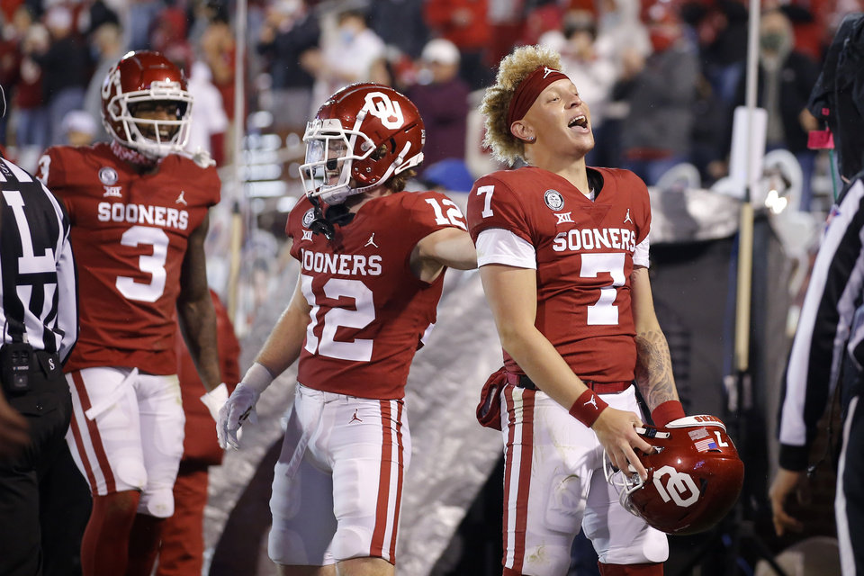 Photo - Oklahoma's Spencer Rattler (7) celebrates after a throwing a touchdown during a bedlam college football game between the University of Oklahoma Sooners (OU) and the Oklahoma State Cowboys (OSU) at Gaylord Family-Oklahoma Memorial Stadium in Norman, Okla., Saturday, Nov. 21, 2020. Oklahoma won 41-13. [Bryan Terry/The Oklahoman]