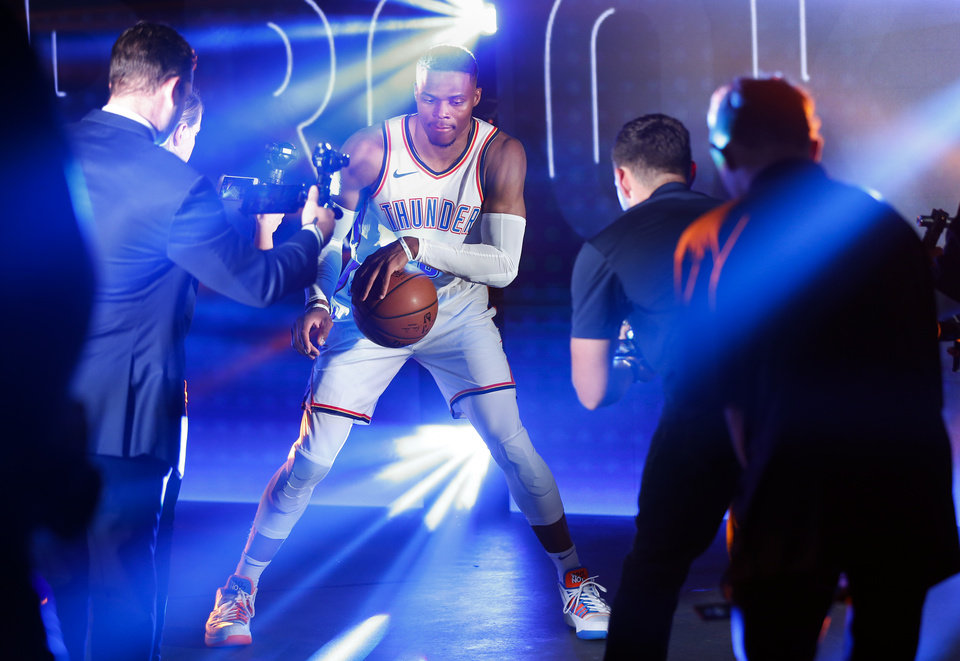 dd7cb3416ce2 Russell Westbrook dribbles during a photo shoot for the NBA at media day  for the Oklahoma City Thunder at Chesapeake Energy Arena in Oklahoma City