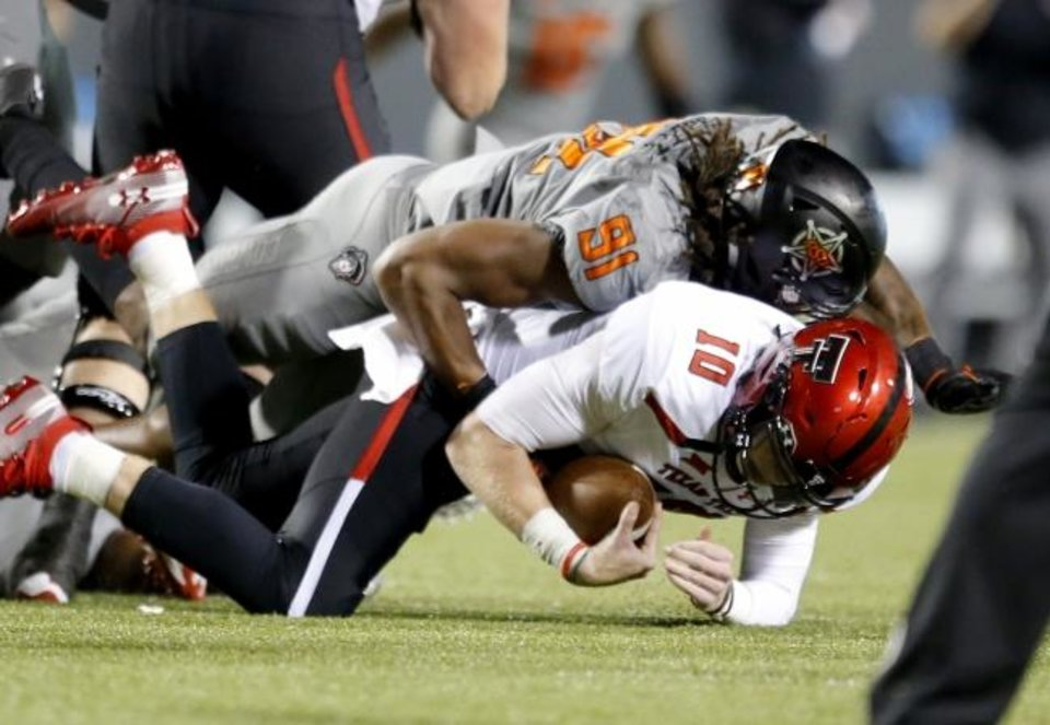 Photo -  Oklahoma State defensive end Mike Scott (91) had three sacks last season, including two against Texas Tech. [Sarah Phipps/The Oklahoman]