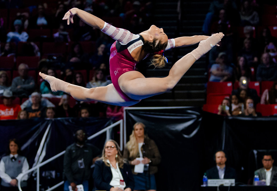 Photo - University of Oklahoma's Maggie Nichols competes in the floor routine during the women's gymnastics competition between the University of Oklahoma and Arkansas at the Lloyd Noble Center in Norman, Okla Monday, Jan. 20, 2020.   [Chris Landsberger/The Oklahoman]
