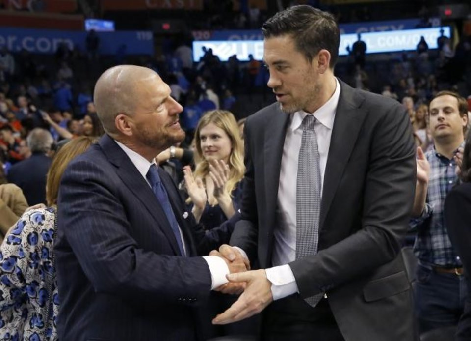 Photo -  Nick Collison shakes hands with Thunder team chairman Clay Bennett following a game against the Raptors on March 20, 2019, the night OKC retired Collison's jersey. [Sarah Phipps/The Oklahoman]
