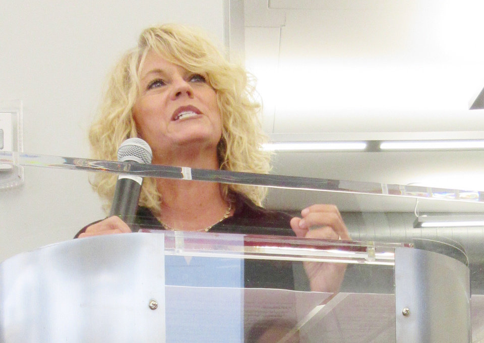 Photo -  Coach Sherri Coale makes a major point at the podium. PHOTO BY HELEN FORD WALLACE, THE OKLAHOMAN