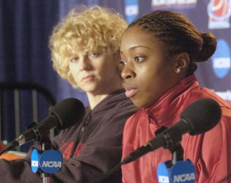 Photo -  Knoxville, TN. 3/19/05 NCAA WOMEN'S REGIONAL IN KNOXVILLE   Sooner Head Coach Sherri Coale listens as Dionnah Jackson talks to reporters during a press conference at the 2005 NCAA Women's Chattanooga Regional First Round in Knoxville, TN.   By Paul Hellstern/The Oklahoman