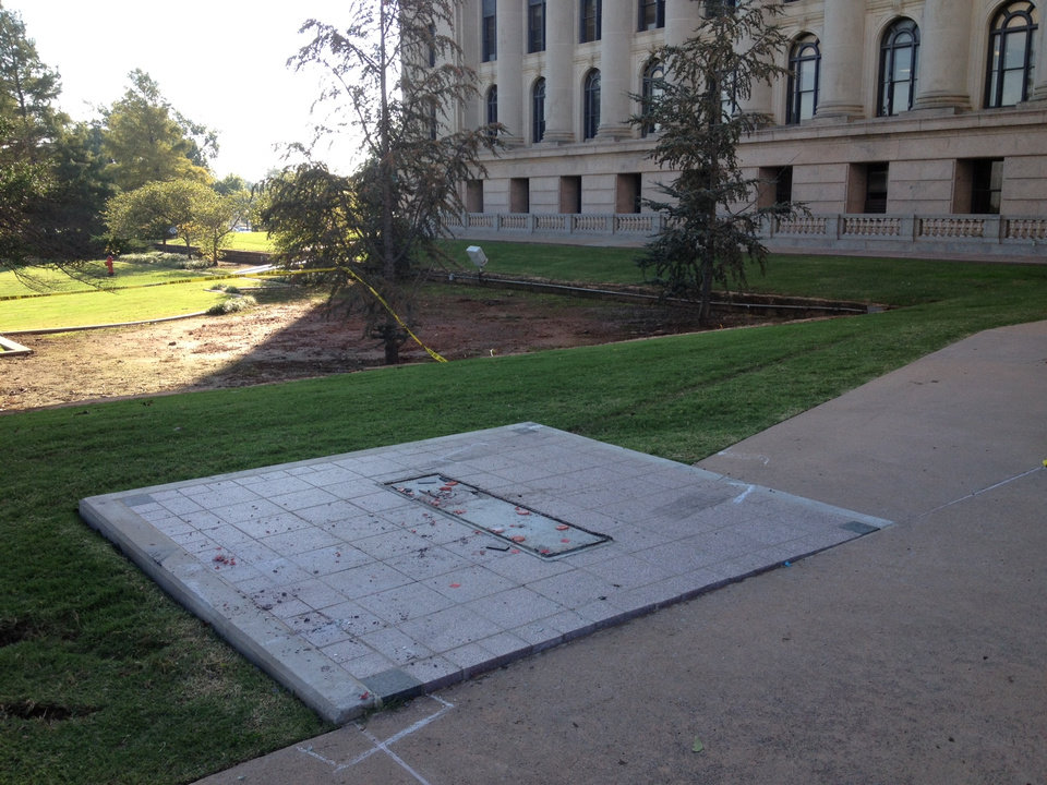 Photo -  The space where a Ten Commandments monument was is seen Friday at the Capitol. Photo by Steve Gooch, The Oklahoman