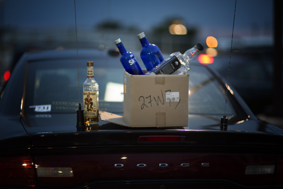 Photo - Bottles of alcohol found in a car during a recent ENDUI checkpoint. Photo: J Pat Carter