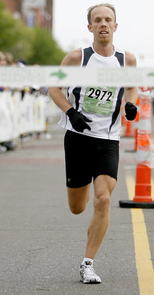 Photo - RUN, RUNNER, RUNNING, WIN, WINNER: Nathan Adams wins the Oklahoma City Memorial Marathon, Sunday, April 27, 2008.  BY BRYAN TERRY, THE OKLAHOMAN ORG XMIT: KOD
