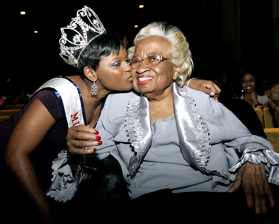 Photo - Clara Luper is greeted by Miss Black Oklahoma Tinasha Williams (left) prior to the Miss Black Langston University 2008 Scholarship Pageant at Langston University, on Sunday, Feb. 24, 2008. By John Clanton, The Oklahoman ORG XMIT: KOD