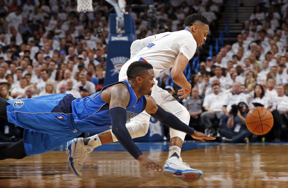 Photo - Dallas' Wesley Matthews (23) and Oklahoma City's Russell Westbrook (0) chase the ball during Game 2 of the first round series between the Oklahoma City Thunder and the Dallas Mavericks in the NBA playoffs at Chesapeake Energy Arena in Oklahoma City, Monday, April 18, 2016. Dallas won 85-84. Photo by Nate Billings, The Oklahoman
