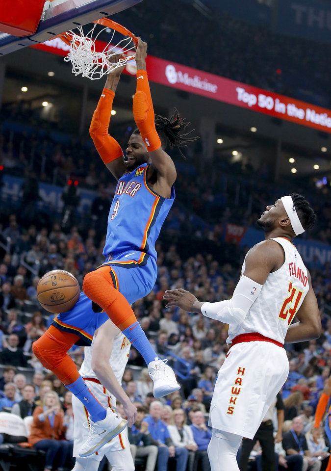 Photo - Oklahoma City's Nerlens Noel (9) dunks the ball in front of Atlanta's Bruno Fernando (24) during the NBA basketball game between the Oklahoma City Thunder and the Atlanta Hawks at the Chesapeake Energy Arena in Oklahoma City,Friday, Jan. 24, 2020.  [Sarah Phipps/The Oklahoman]