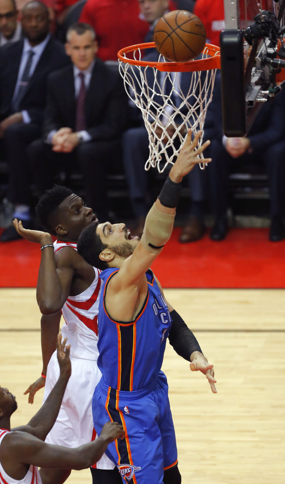 Photo - Oklahoma City's Enes Kanter (11) puts up a shot beside Houston's Clint Capela (15) during Game 2 in the first round of the NBA basketball playoffs between the Oklahoma City Thunder and the Houston Rockets at the Toyota Center in Houston, Texas,  Wednesday, April 19, 2017.  Photo by Sarah Phipps, The Oklahoman