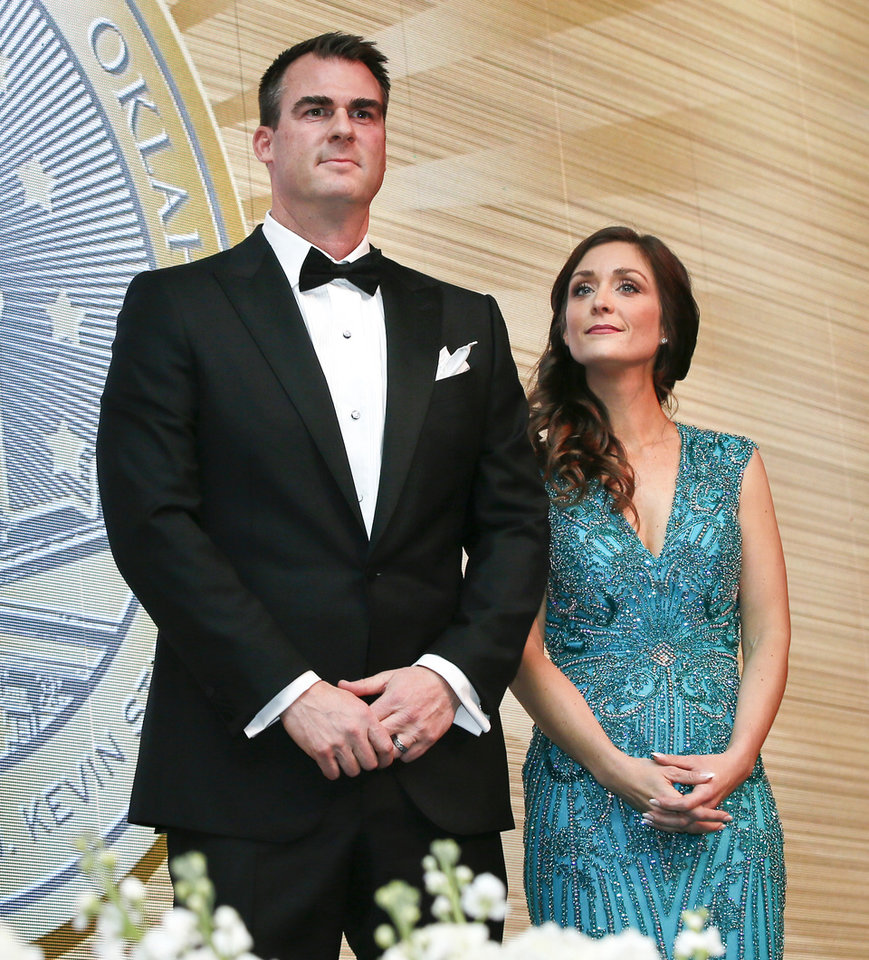 Photo - Gov. Kevin Stitt and first lady Sarah Stitt stand on stage together during the inaugural ball for Stitt at the Cox Convention Center in Oklahoma City, Monday, Jan. 14, 2019. Photo by Nate Billings, The Oklahoman