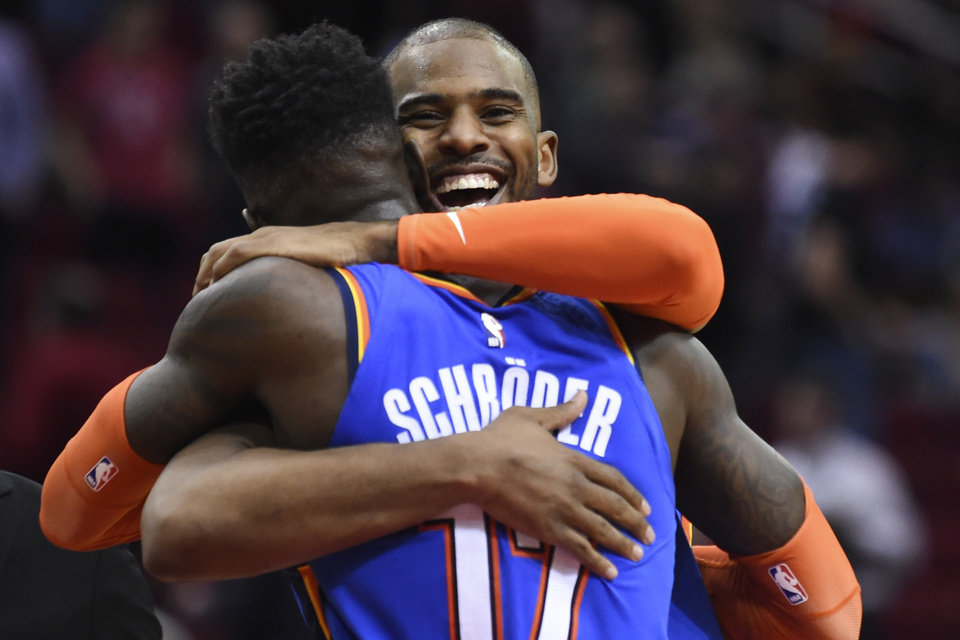 Photo - Oklahoma City Thunder guard Chris Paul, right, celebrates the team's win with guard Dennis Schroder in an NBA basketball game against the Houston Rockets, Monday, Jan. 20, 2020, in Houston. (AP Photo/Eric Christian Smith)