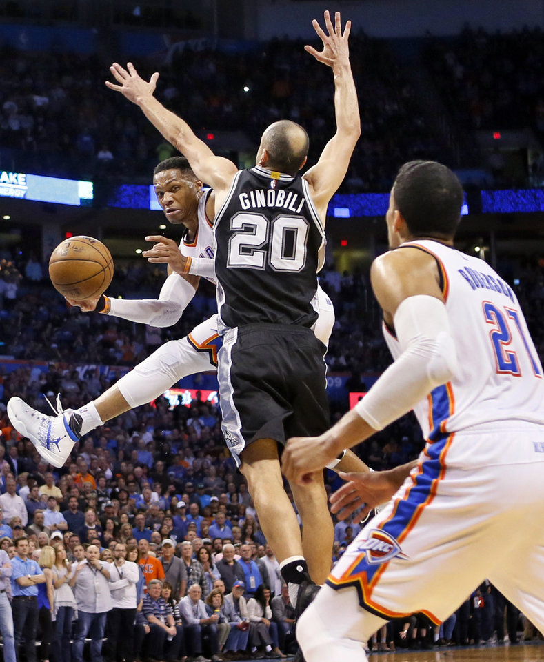 Photo - Oklahoma City's Russell Westbrook (0) passes to Andre Roberson (21) around San Antonio's Manu Ginobili (20) during an NBA basketball game between the Oklahoma City Thunder and San Antonio Spurs at Chesapeake Energy Arena in Oklahoma City, Friday, March 31, 2017. San Antonio won 100-95. Photo by Nate Billings, The Oklahoman
