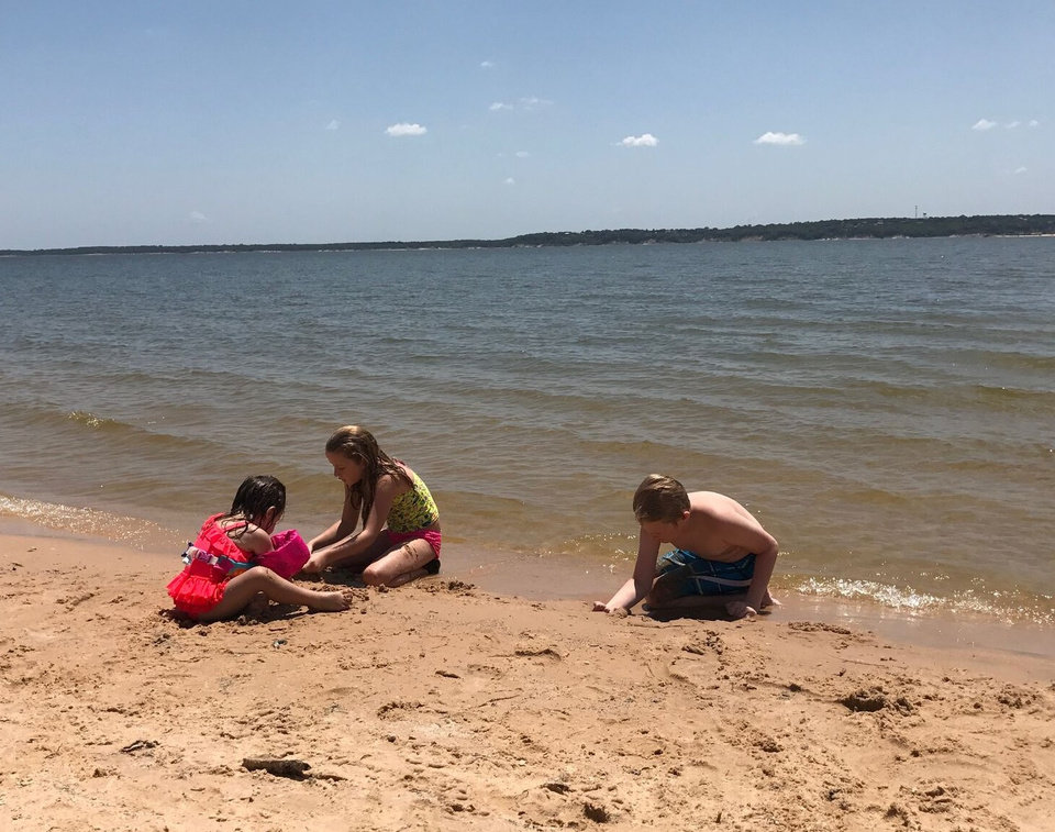 Photo -  Children play at Lake Texoma. [PHOTO PROVIDED BY JASON HIGHTOWER/LAKE HOMES REALTY]