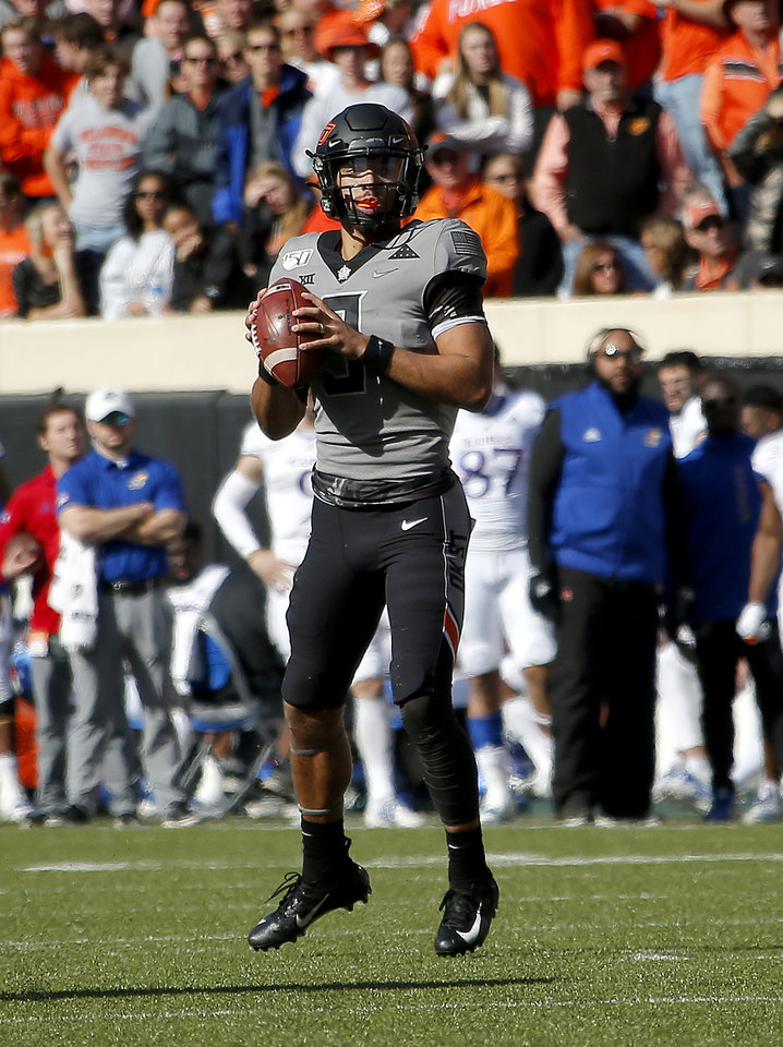 Photo - Oklahoma State's Spencer Sanders (3) looks to throw a pass in the second quarter during the college football game between the Oklahoma State University Cowboys and the Kansas Jayhawks at Boone Pickens Stadium in Stillwater, Okla., Saturday, Nov. 16, 2019. OSU won 31-13. [Sarah Phipps/The Oklahoman]