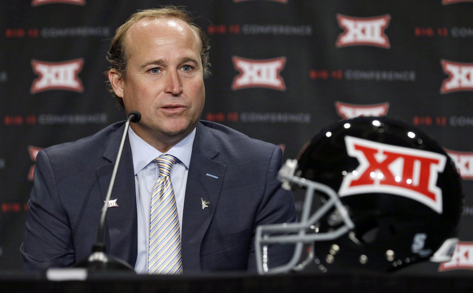 Photo - West Virgina head coach Dana Holgorsen  answers a question from a reporter during the NCAA college Big 12 Conference football media days in Dallas, Tuesday, July 22, 2014. (AP Photo)