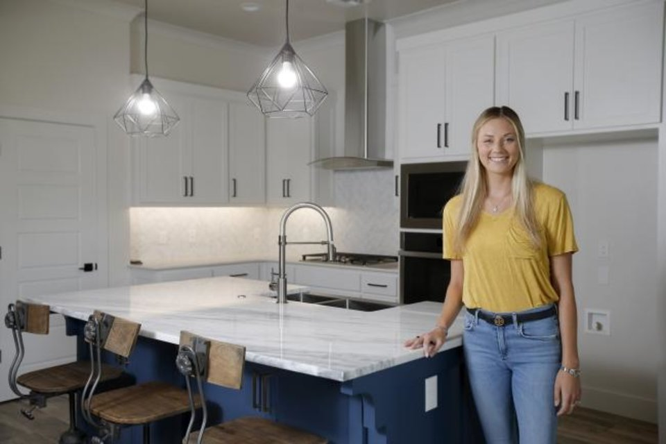 Photo -  Cougar Homes builder Savannah Horn shows the bright and open kitchen at 2215 Kimball Drive, which the company built to be the featured show home for the Festival of Homes. [BRYAN TERRY/THE OKLAHOMAN]