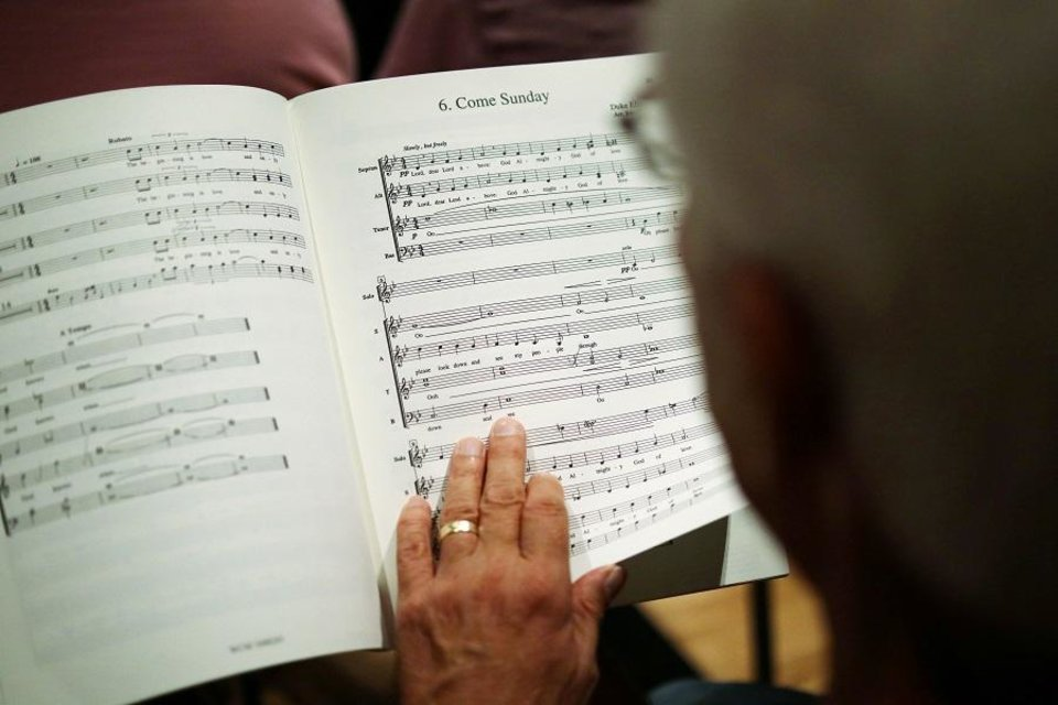 Photo - A Canterbury Voices singer rehearses for the choir's Oct. 13 performance of Duke Ellington's