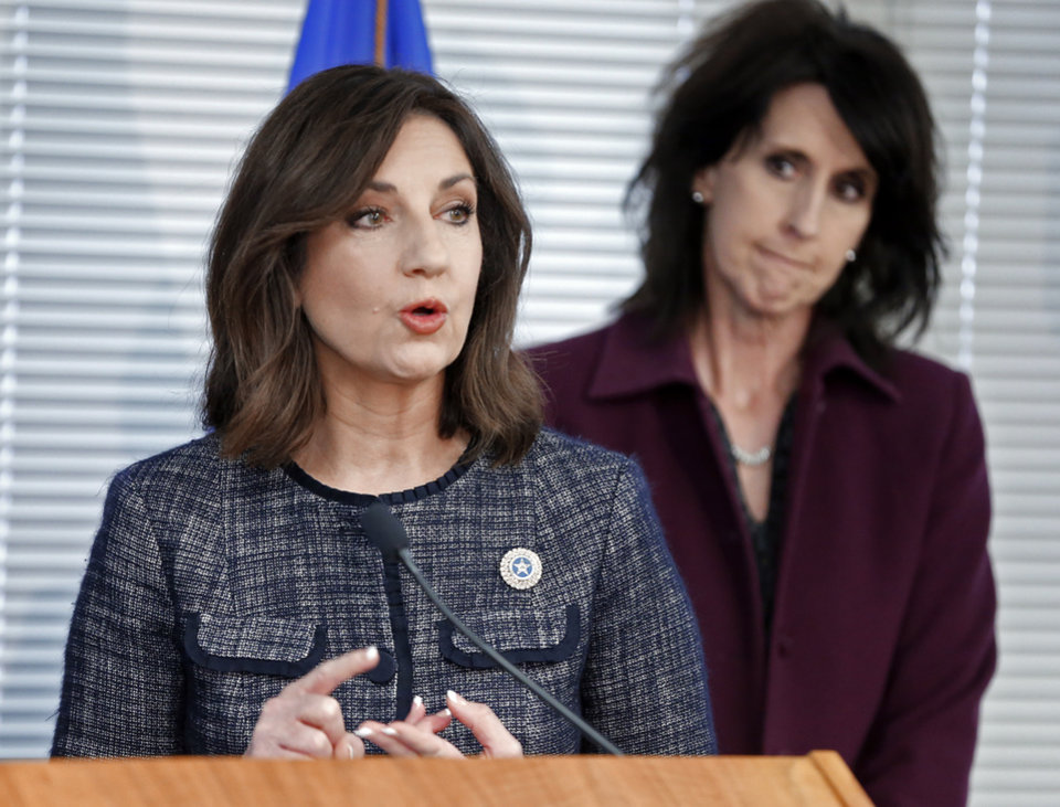 Photo - Oklahoma's State Superintendent of Public Instruction Joy Hofmeister holds a news conference on Monday, Jan. 22, 2018 in Oklahoma City, Okla.   The extensive survey addresses reasons why certified teachers have left the field.  Behind her is Robyn Miller.  Photo by Steve Sisney, The Oklahoman