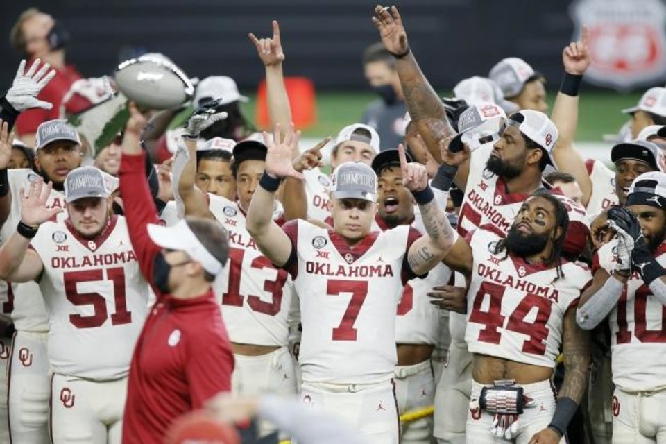 Photo -  Oklahoma's Spencer Rattler (7) and Brendan Radley-Hiles (44) celebrate with the Oklahoma team after the Big 12 Championship Game between the University of Oklahoma Sooners (OU) and the Iowa State Cyclones at AT&T Stadium in Arlington, Texas, Saturday, Dec. 19, 2020. Oklahoma won 27-21. [Bryan Terry/The Oklahoman]