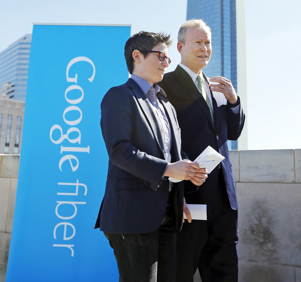 Photo - Jill Szuchmacher, director of expansion for Google Fiber, left, and Mayor Mick Cornett talk after announcing Google Fiber's decision to explore bringing its service to Oklahoma City, on the rooftop of the Oklahoma City Museum of Art in downtown Oklahoma City, Wednesday, Oct. 28, 2015. Photo by Nate Billings, The Oklahoman
