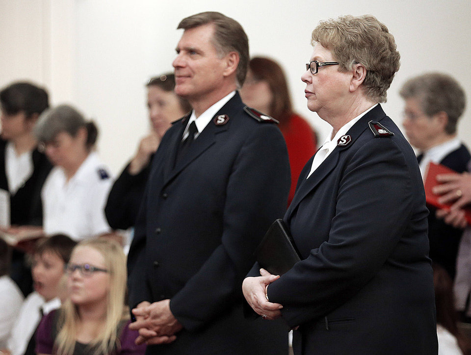 Photo - Commissioners David and Barbara Jeffery listen to a sermon during the Salvation Army Central Oklahoma Soldiers' Rally in Oklahoma City, Saturday, March 22, 2013. Photo by Sarah Phipps, The Oklahoman