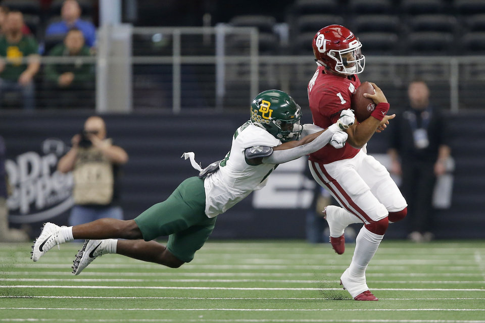 Photo - Oklahoma's Jalen Hurts (1) runs past Baylor's Christian Morgan (15) during the Big 12 Championship Game between the University of Oklahoma Sooners (OU) and the Baylor University Bears at AT&T Stadium in Arlington, Texas, Saturday, Dec. 7, 2019. [Bryan Terry/The Oklahoman]
