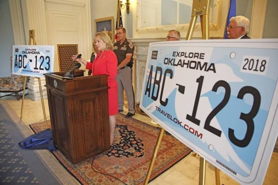 Photo -  Gov. Mary Fallin speaks in 2016 at the unveiling of the new design for the state's license plate at the state Capitol. [The Oklahoman Archives]