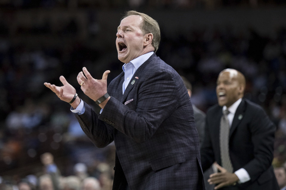 Photo - Mississippi head coach Kermit Davis reacts after a play against Oklahoma during a first round men's college basketball game in the NCAA Tournament Friday, March 22, 2019, in Columbia, S.C. (AP Photo/Sean Rayford)