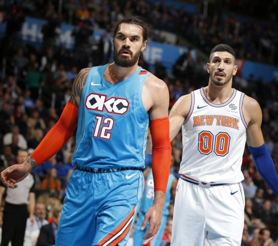 Photo -  Enes Kanter, shown here with the New York Knicks, stands next to good friend and former Oklahoma City teammate Steven Adams during a 2018 game. Kanter remains a fan favorite in OKC. [Sarah Phipps/ The Oklahoman]