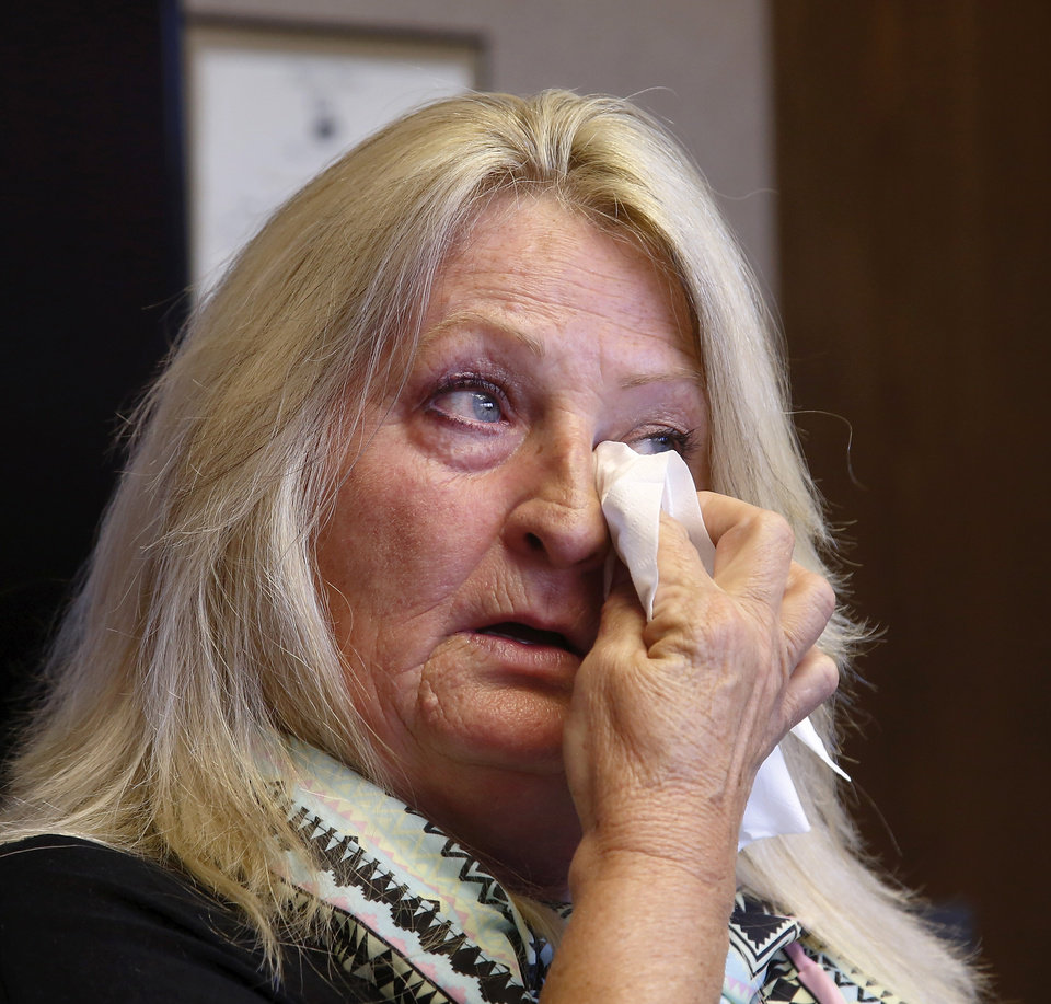 Photo -  Michael Tate Reed II's mother , Crystal Tucker, wipes tears when discussing the emotional toll her son's mental illness and his behavior have created for her family and for Reed during an interview in the office of the Mental Health Association Oklahoma in Tulsa on Wednesday, Oct. 29, 2014. Reed has suffered from serious mental illness for at least two years, his family says. Reed hasn't ever been formally diagnosed, but mental health experts have told the family that Reed likely has schizoaffective disorder, a brain disease that is a mix of schizophrenia and bipolar disorder. Reed is at a mental health facility, and his family and friends hope he doesn't have to spend time in prison when they say he's suffering from a mental illness and is not a terrorist or Satanist, as some have called him after he admitted to law officers that he drove his vehicle onto the lawn of the state Capitol and crashed into the Ten Commandments monument, toppling it from its base and breaking it into several pieces. Photo by Jim Beckel, The Oklahoman   Jim Beckel -  THE OKLAHOMAN