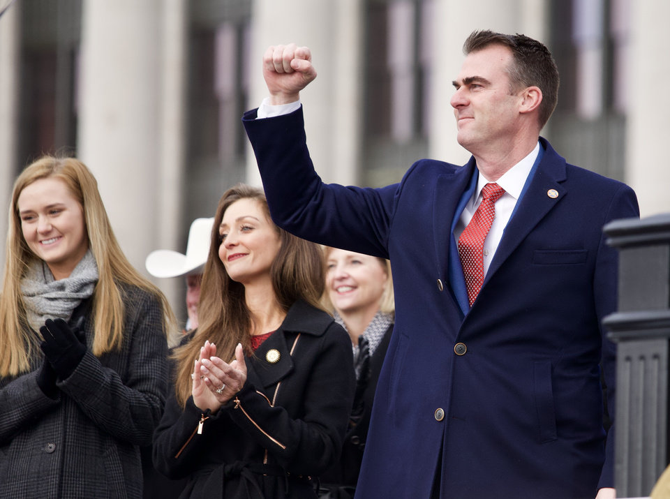 Photo - Gov. Kevin Stitt takes his oath of office as he is sworn in during the inauguration ceremony of new Oklahoma Gov. Kevin Stitt at the Oklahoma State Capitol in Oklahoma City, Okla. on Monday, Jan. 14, 2019. Photo by Chris Landsberger, The Oklahoma