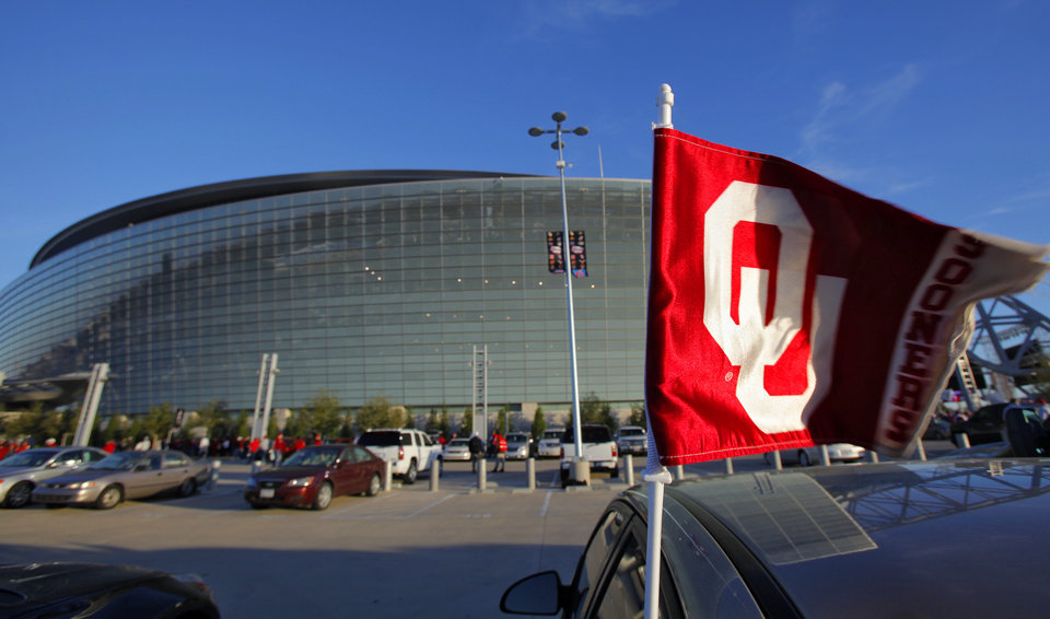 Photo - An Oklahoma car flag blows in the wind outside the stadium during the Big 12 football championship game between the University of Oklahoma Sooners (OU) and the University of Nebraska Cornhuskers (NU) at Cowboys Stadium on Saturday, Dec. 4, 2010, in Arlington, Texas.  Photo by Chris Landsberger, The Oklahoman