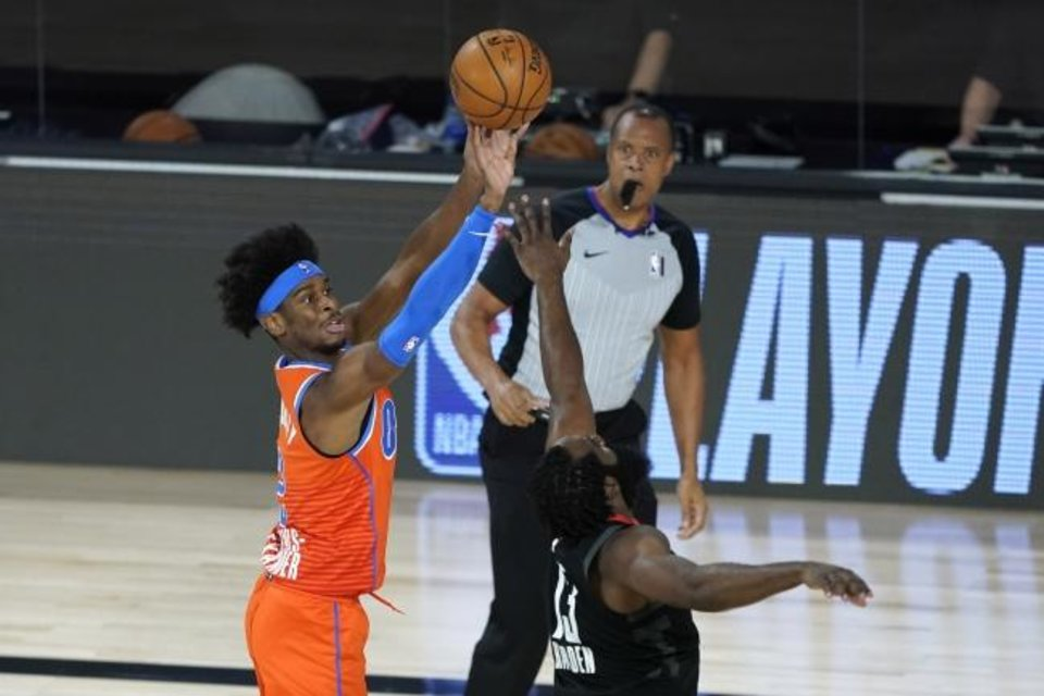 Photo -  Oklahoma City's Shai Gilgeous-Alexander (2) shoots over Houston's James Harden (13) during the first half Saturday. Gilgeous-Alexander finished with just four points. [AP Photo/Ashley Landis]