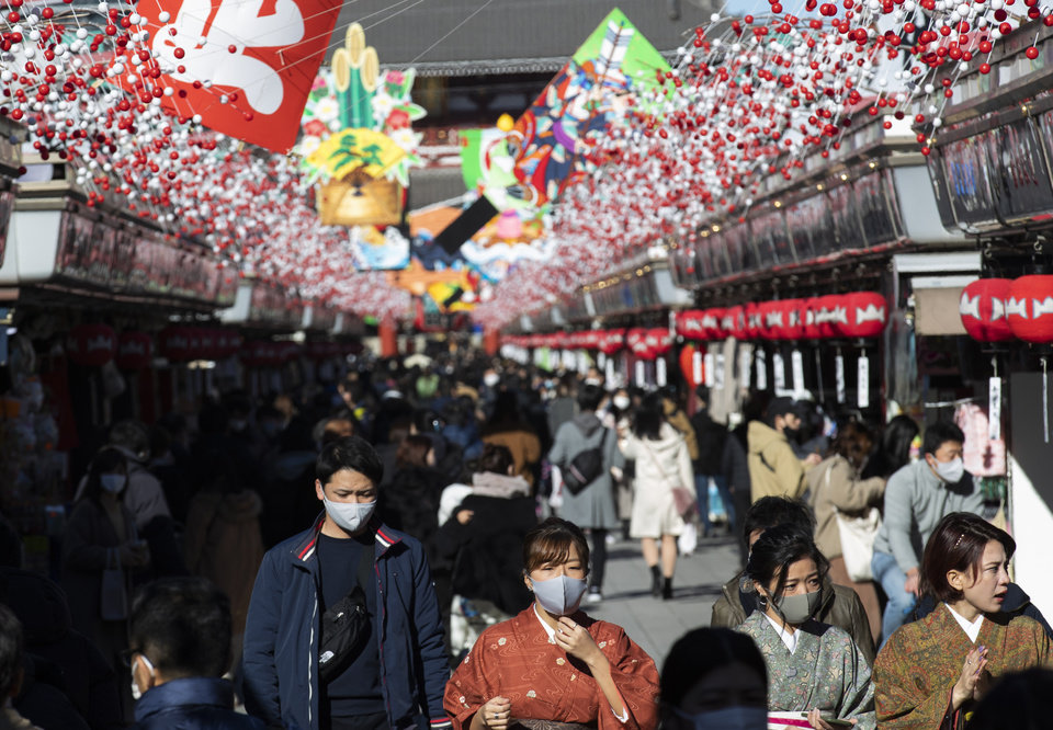 Photo -  People wearing face masks to help curb the spread of the coronavirus visit Sensoji temple on New Year's Eve in Tokyo. [Hiro Komae/AP Photo]