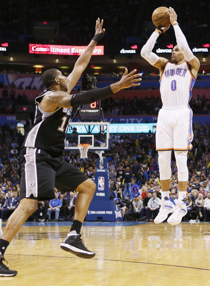 Photo - Oklahoma City's Russell Westbrook (0) shoots against San Antonio's LaMarcus Aldridge (12) during an NBA basketball game between the Oklahoma City Thunder and San Antonio Spurs at Chesapeake Energy Arena in Oklahoma City, Friday, March 31, 2017. San Antonio won 100-95. Photo by Nate Billings, The Oklahoman