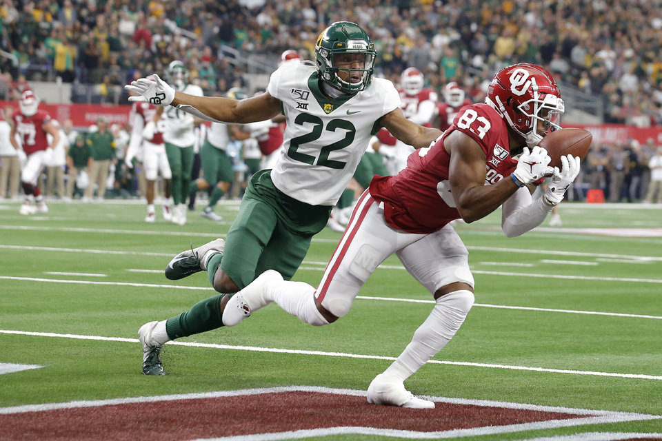 Photo - Oklahoma's Nick Basquine (83) catches a touchdown pass in front of Baylor's JT Woods (22) during the Big 12 Championship Game between the University of Oklahoma Sooners (OU) and the Baylor University Bears at AT&T Stadium in Arlington, Texas, Saturday, Dec. 7, 2019. Oklahoma won 30-23. [Bryan Terry/The Oklahoman]