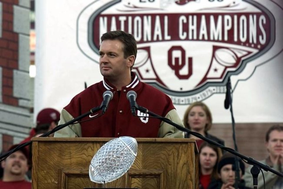 Photo -  OU coach Bob Stoops addresses the crowd at the Sooner Championship Celebration program in Norman on Jan. 21, 2001. Stoops retired in 2017 after 18 seasons and 10 Big 12 Conference titles. [AP Photo/J. Pat Carter]