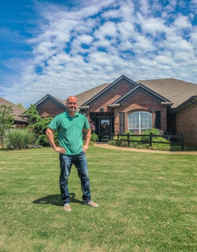 Photo -  Trevor Sipes, broker-owner of ShowOKC Real Estate, with a home he has listed for sale. [PHOTO PROVIDED]